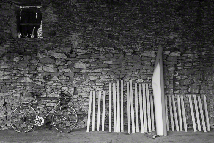 Bicycle, stretcher bars, canvas, stone wall